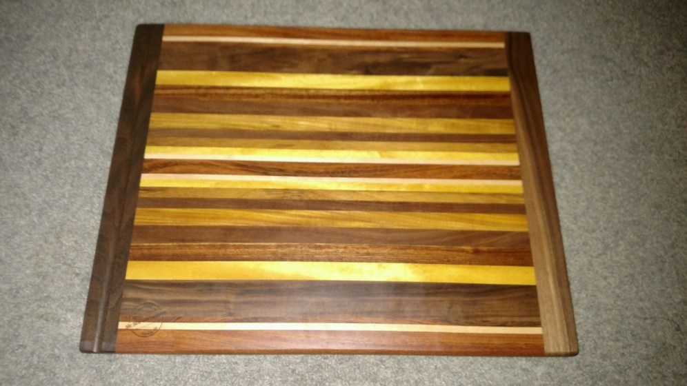 "Cutting Board 16 - Edge 005. Bread Board Ends; in-counter replacement. Commissioned Piece. Black Walnut, Jatoba, Hard Maple, Yellowheart, Caribbean Rosewood, Canarywood & Teak. 16"" x 20"" x 3/4""."